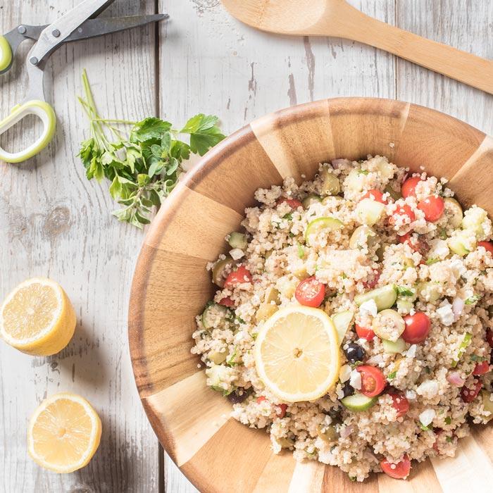 zesty quinoa salad with greek flavors and lemon vinaigrette