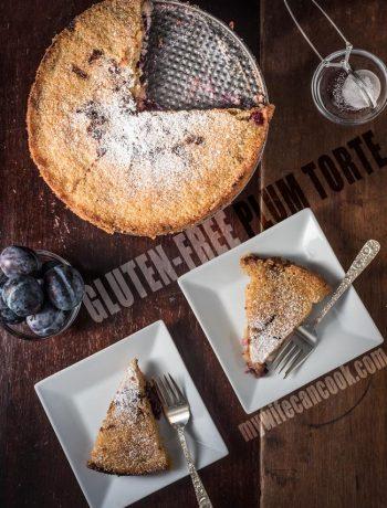 gluten-free plum torte dessert with powdered sugar